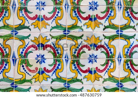 green, yellow, red and blue colored azulejos - tiles from Lisbon, Portugal
