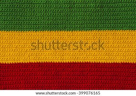 Green, yellow, red crochet reggae colors background - stock photo