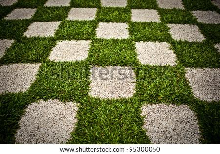 Green Zen garden. Chequered Grass. Background photo. - stock photo
