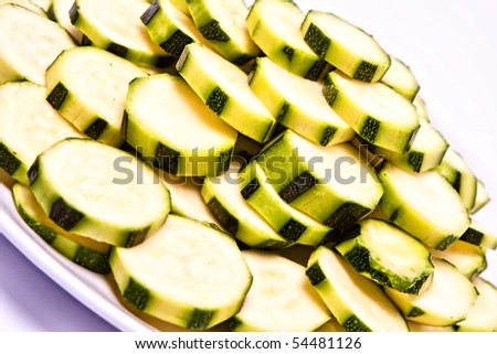 green zucchini peeled and sliced