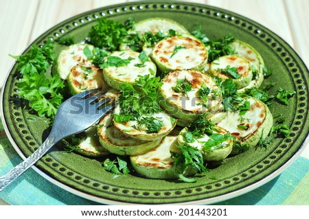 Green zucchini sliced with parsley and fennel - stock photo