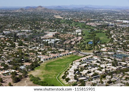 Greenbelt and wash with Golf Course in North Phoenix - stock photo