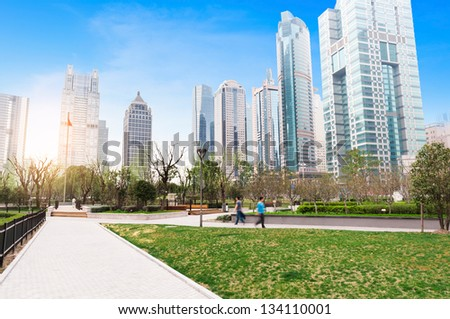 greenbelt park with lujiazui finance and trade zone in shanghai - stock photo