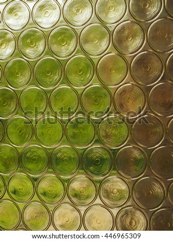 Greenery seen through decorated glass useful as a background
