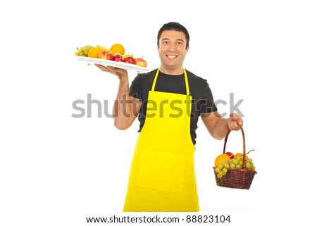 Greengrocer holding full plateau and basket with fresh fruits isolated on white background