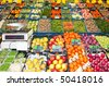 Greengrocers' shop, with an electronic scale, and various boxes and crates with fresh fruit and vegetables on display - stock photo