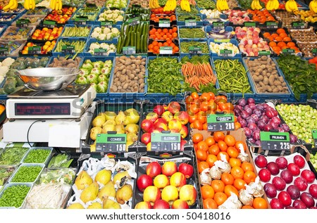 Greengrocers' shop, with an electronic scale, and various boxes and crates with fresh fruit and vegetables on display