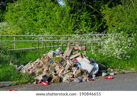 GREENHILL, KENT, UK - MAY 4, 2014: Fly Tipping is an increasing problem for farmers.  There were 711,000 incidents of fly tipping during 2012/13 (source NFU). - stock photo