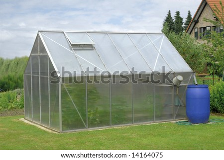 greenhouse in garden - stock photo