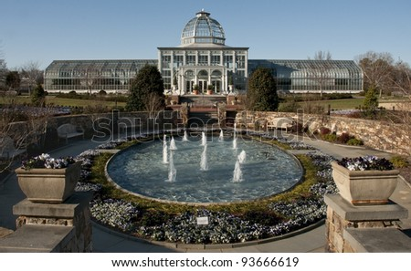 Greenhouse with fountain - stock photo