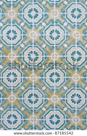 Greenish and yellow pattern made of tiles - stock photo