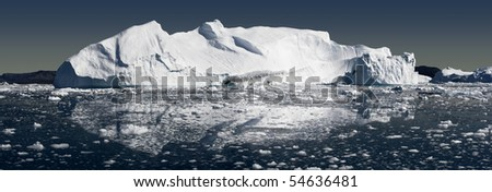 Greenland. A panoramic picture of an iceberg in a clear sunny day. - stock photo