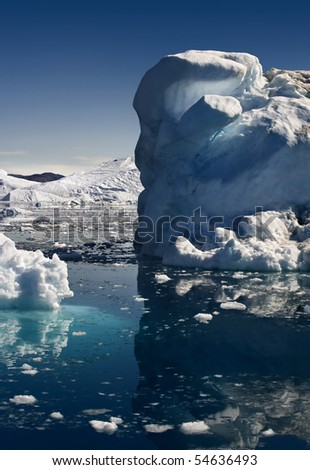 Greenland. An iceberg and its reflexion in a beautiful still water. - stock photo