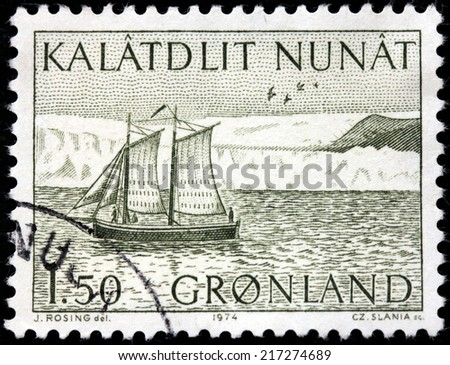 GREENLAND - CIRCA 1974: A stamp printed by DENMARK shows postal deliveries in Greenland by fishing boat, circa 1974