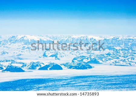 Greenland from a plane - stock photo