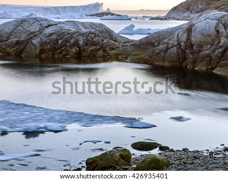 Greenland Icebergs and glaciers, with long exposure shot. - stock photo