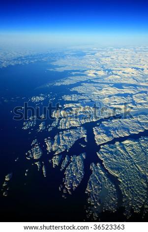 greenland shore with snow rocks - stock photo