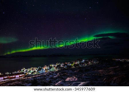 Greenlanic Northern lights, nearby Nuuk, Greenland - stock photo