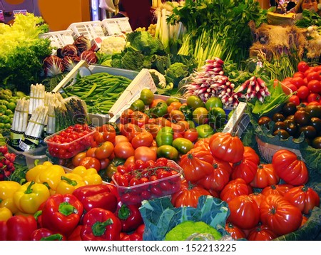 Greens and vegetables at the market stall - stock photo