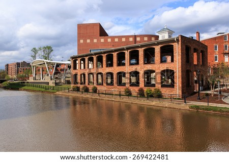 GREENVILLE, SOUTH CAROLINA - APRIL 9, 2015:  This historic landmark building was once a thriving paint factory on the banks of the Reedy River and is now used for outdoor events.