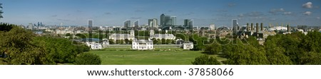 Greenwich and Canary Wharf. Panoramic of London's National Maritime Museum and skyscraper of Canary Wharf. - stock photo