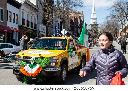"""Greenwich, CT, USA - March 22nd, 2015: The individuals are some of the many participants in the  """"Annual St. Patrick's Day"""" parade held on March 22nd, 2015 in downtown Greenwich Connecticut.  - stock photo"""