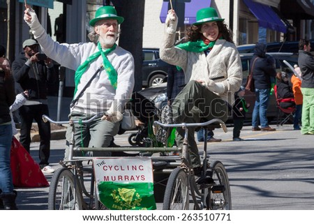 "Greenwich, CT, USA - March 22nd, 2015: The individuals are some of the many participants in the  ""Annual St. Patrick's Day"" parade held on March 22nd, 2015 in downtown Greenwich Connecticut."