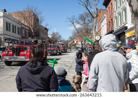 """Greenwich, CT, USA - March 22, 2015: Spectators enjoying the  """"Annual St. Patrick's Day"""" parade held on March 22, 2015 in downtown Greenwich Connecticut.  - stock photo"""
