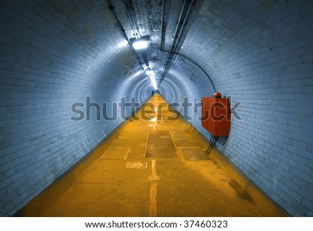 Greenwich Foot Tunnel.A long tunnel,  Greenwich, London. - stock photo