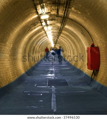 Greenwich Foot Tunnel A long tunnel,  Greenwich, London. - stock photo