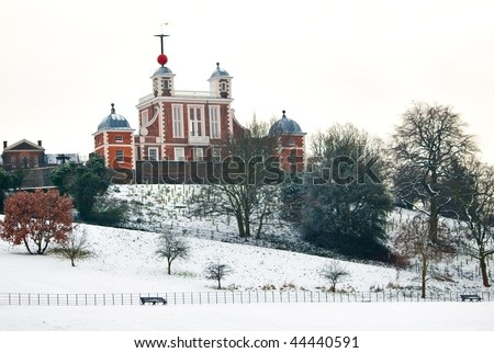 Greenwich observatory covered in deep snow in a cold winter day - stock photo