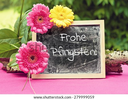 greeting card background for your text - blackboard - german for happy pentecost - stock photo