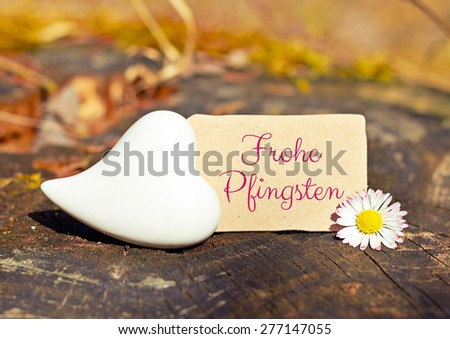 greeting card background - german for happy pentecost - stock photo