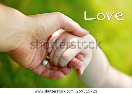 greeting card background - hands of mother and child - stock photo
