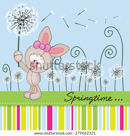 Greeting card Cute Rabbit with dandelion on a meadow  - stock photo