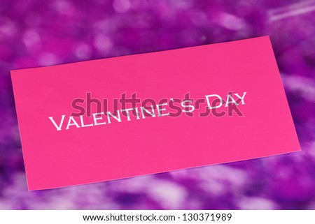 Greeting card for Valentine's Day on purple background - stock photo