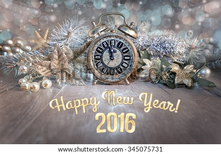 "Greeting card ""Happy New Year 2016!"" with vintage clock showing five to midnight and sparkling decorations. This image is toned. Shallow DOF, focus on the clock - stock photo"