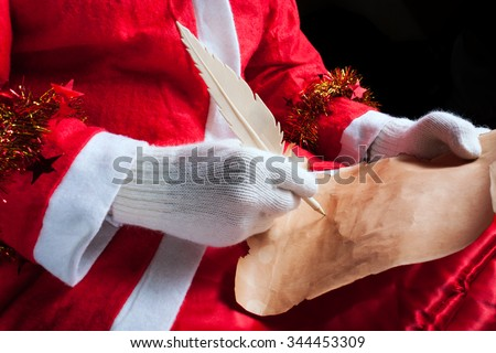 Greeting Card of New Year 2016. Santa Claus holding blank sheet of paper and writing down something