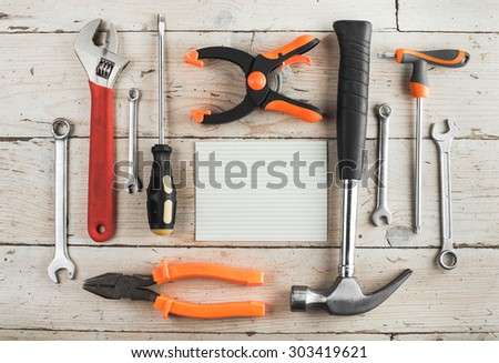 Greeting Card to Happy Father's Day, Happy Birthday Dad, concept, set of different tools: a hammer, wrench, screwdriver, spanners, clamp, tablet for an inscription, text, closeup, top view - stock photo