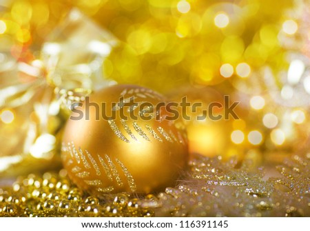 Greeting card with Christmas ball in gold design - stock photo