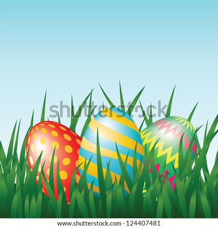 Greeting card with easter eggs on meadow