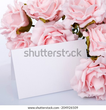 Greeting card with pink roses on a white background