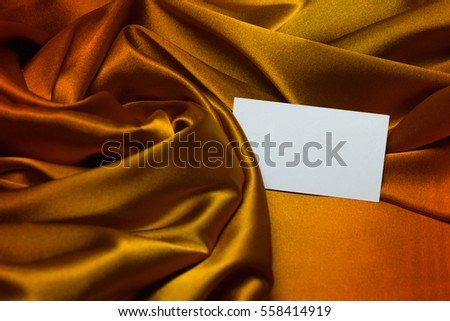 Greeting card with space for text on a luxury satin fabric, romantic concept