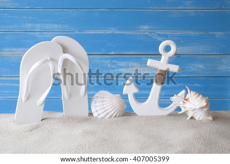 Greeting Card With Summer Decoration Like Anchor And Flip Flops - stock photo