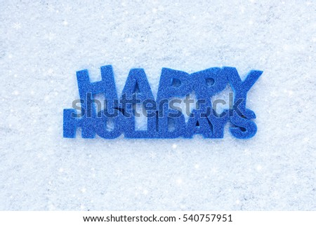 "Greeting ""Happy Holidays"" is on snow"