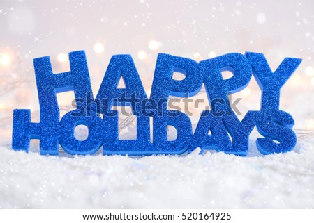 "Greeting ""Happy Holidays"" is on snow on a festive background"