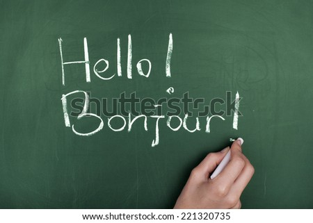 Greeting in French and English - stock photo