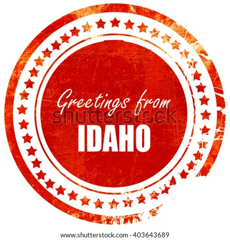 Greetings from idaho, grunge red rubber stamp on a solid white b