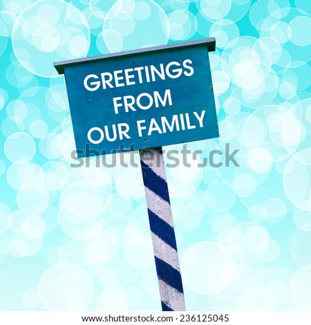 Greetings from our family card written on blue background with defocused lights - stock photo