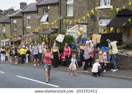 Greetland, England, JUL 06:  Crowd of people wainting for the cyclists on Hullen edge lane during the stage 2 of Le Tour de France on July 06 2014 in Greetland, England.